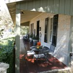 Charming covered porch with rockers and seasonal decor welcomes you!