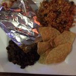 Soft chicken tacos with rice, black beans, chips, and salsa.