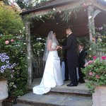 Outside wedding ceremony in the pergola