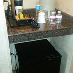 """Mini fridge and coffee maker in the """"Family Room""""."""