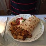 Scrambled eggs, cheddar cheese, onion, pepper, tomato + salsa wrapped in flat bread. Served with
