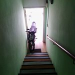 Stairway leading to hostel note motorcycle