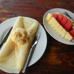 Banana pancake with ice cream and a portion of fresh fruits