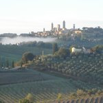 Morning fog lifting over San Gimignano viewed from Podere Lo Spadino