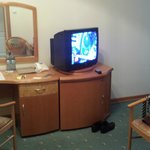 Sitting room with desk and television