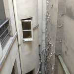 The breakfast crew clanged pots & pans at bottom of this 'courtyard', reverberating off all wall