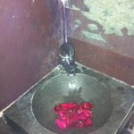 Washing hands in a rose petal basin. Wonderful.