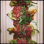 Stuffed peppers - Summer Seasonal Collection. Local peppers stuffed with an organic sausage topp