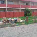 trash dumped from rooms and not hauled away properly