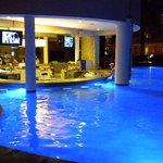 Swim-up bar at night