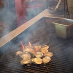 flame grilling specialty oysters