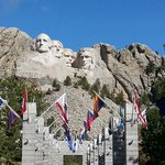 Mount Rushmore with flags in front