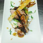 Duck breast drizzled with tea herb dressing