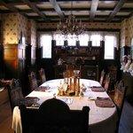 Dining room with dark, hardwood paneling