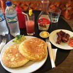 Pancakes, bacon and strawberry juice