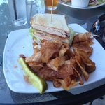 One half of my turkey club, with associated chips and pickle.