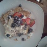 Brioche French toast with lemon crema, fresh berries and slivered toasted almonds.  Yummy!