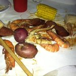 This is my dinner dumped on the table for me to eat with mallots to crack the crab, lol!  Delici