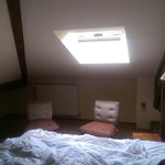 Bedroom, confined and dark. Sloped ceiling hardy room to walk