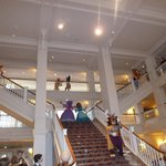 Characters dancing on hotel stairs