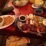 Steak and shrimp over chicken fajitas