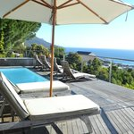 Small plunge pool on the terrace overlooking the city and sea