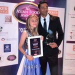 Shaish and Yasmin receiving a award,for THE LITTLE GEM OF WALES