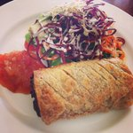 Homemade sausage roll with tomato relish
