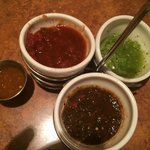 Top left, traditional salsa; top right, tropical; bottom, roasted peppers; small cup, habanero.