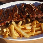 Rack of BBQ ribs with French Fries and Coleslaw