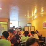 Dinner crowd at a light and airy Saigon Kitchen