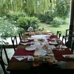 Beautifully set breakfast table with view of the garden.