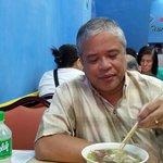 My husband, enjoying the roasted duck soup