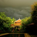 The pool area and restaurant as a storm rolls in