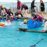School group having fun raft building