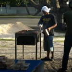 One of the locals grilling food
