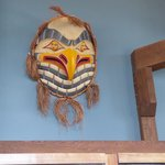 mask on the wall of the restaurant