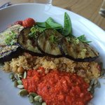 Vegan grilled aubergine slices with roast vegetable cous cous, tomato sauce and grilled cherry t
