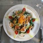 A main dish for lunch salad with smoked salmon
