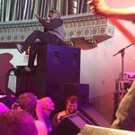 """Singer on top of amps during encore playing """"Cult of Personality"""""""