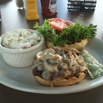 Elk burger with mushrooms and side of potato salad