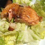 Caesar salad with salmon cooked to order