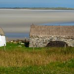 One of the northern beaches of N. Uist at low tide behind the black house.