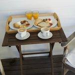 Breakfast with fresh fruit, jams and squeezed orange juice