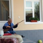 The owner playing dutar