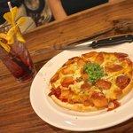 Italian cherry soda and sausage pizza