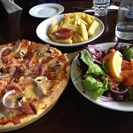 Pizza, fries and salmon salad