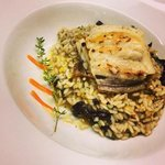 Risotto made of pumpkin and black trumpet mushrooms with Mediterranean dealfish file.