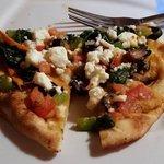 Half of the Hummus Naan pizza... delicious!