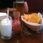 Hot chips, fresh Salsa, and non alcoholic pina colda yummy!